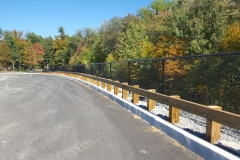 Pressure Treated Guard Rail & Black Chain Link Fence